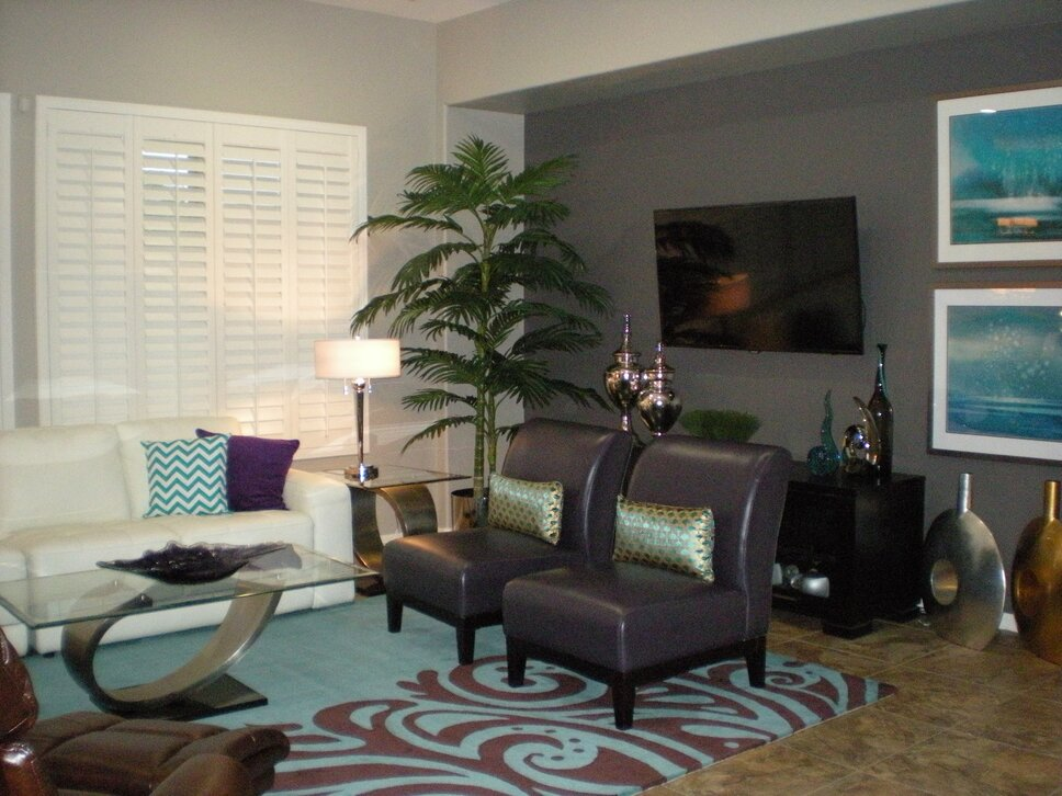 The rug is by Momeni and accessories by Z Galleries. Wall art by art.com. Contemporary Living Room design