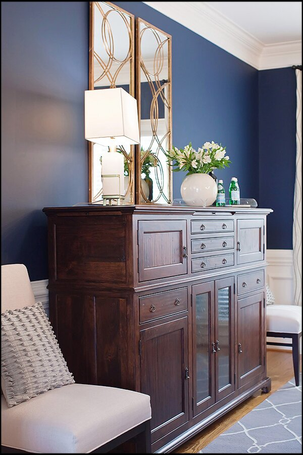 Sideboard from MacKenzie Dow, dining chair from DesignMasters, mirror and lamp from Arteriors Contemporary Dining Room design