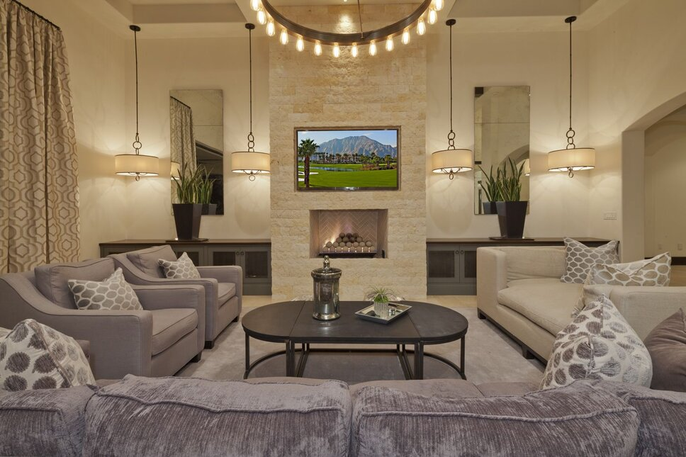Modern take on a Mediterranean living room.  Soothing gray and neutral tons with soft velvet fabrics and simple, elegant lights. Modern Living Room design