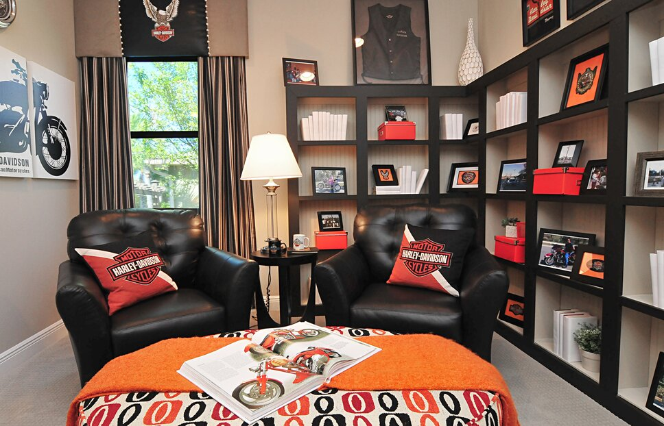 This Harley afficionado loves his den, and relishes the ample spaces to display his unique memorabilia, collectibles, books and photos. Contemporary Home Office design