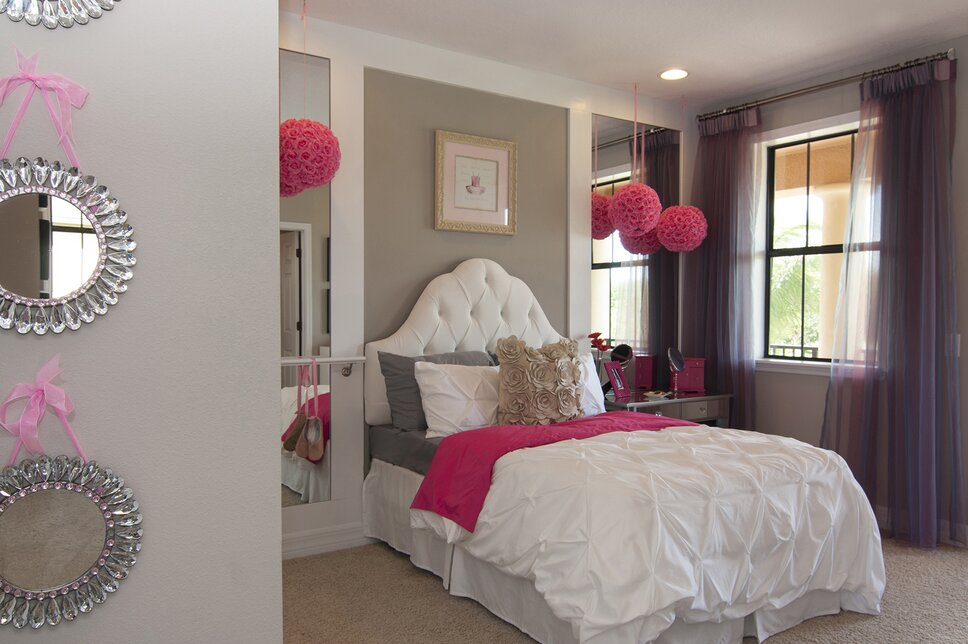 Custom built Headboard wall, featuring flanking mirror insets, and a functional ballet barre, create this adorable budding ballerinas dream bedroom. Glam Kids design