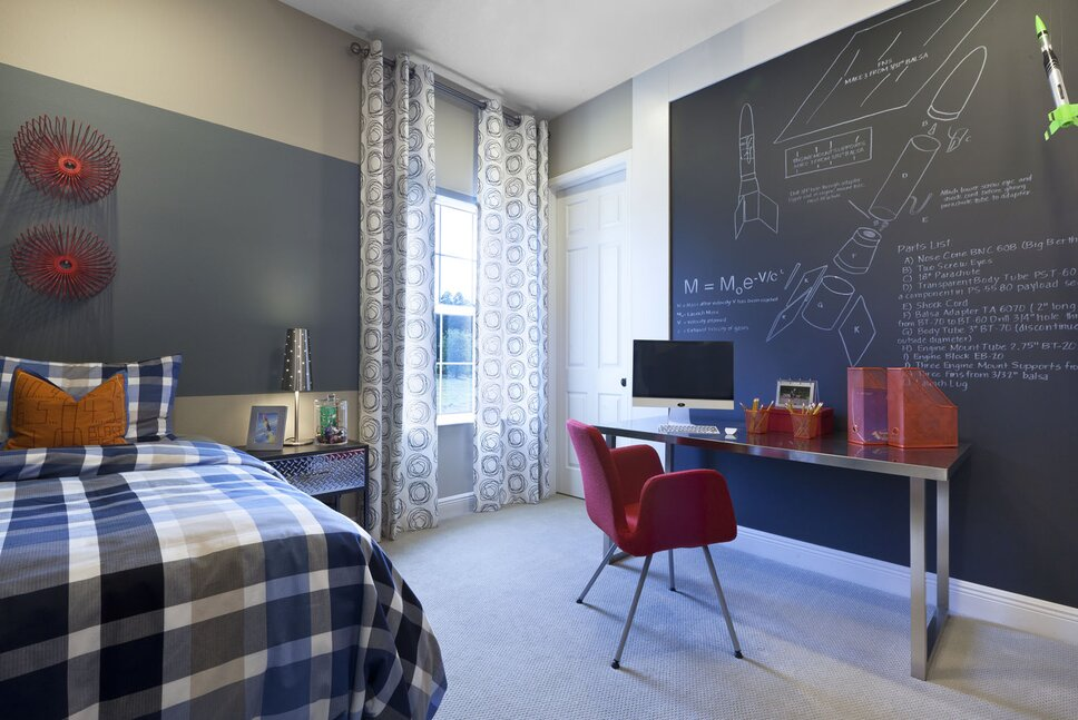 A wall to wall chalkboard, framed with wide flat stock is the highlight of this whimsical, yet functional pre-teens bedroom Contemporary Kids design