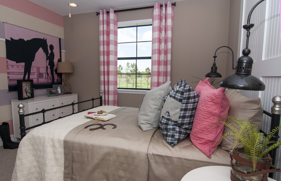 Pink striped walls, gingham curtains, barn-style beadboard headboard and coach lanterns create a charming girls room, inspired by all things equestrian. Contemporary Kids design