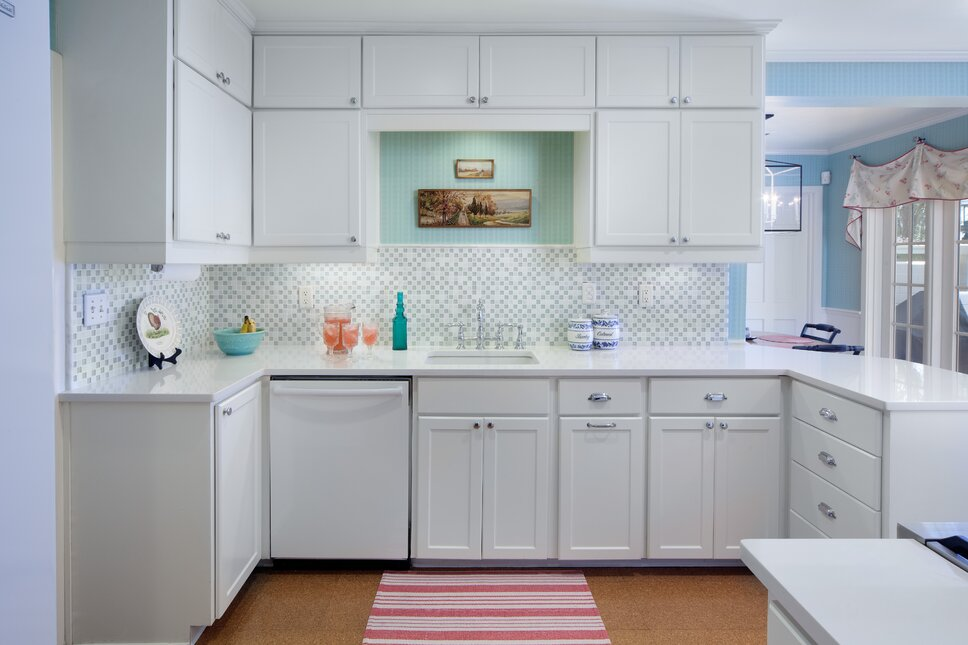 All-white kitchen in a lake front home. Pops of color give the room vibrancy and homey touches. Traditional Kitchen design