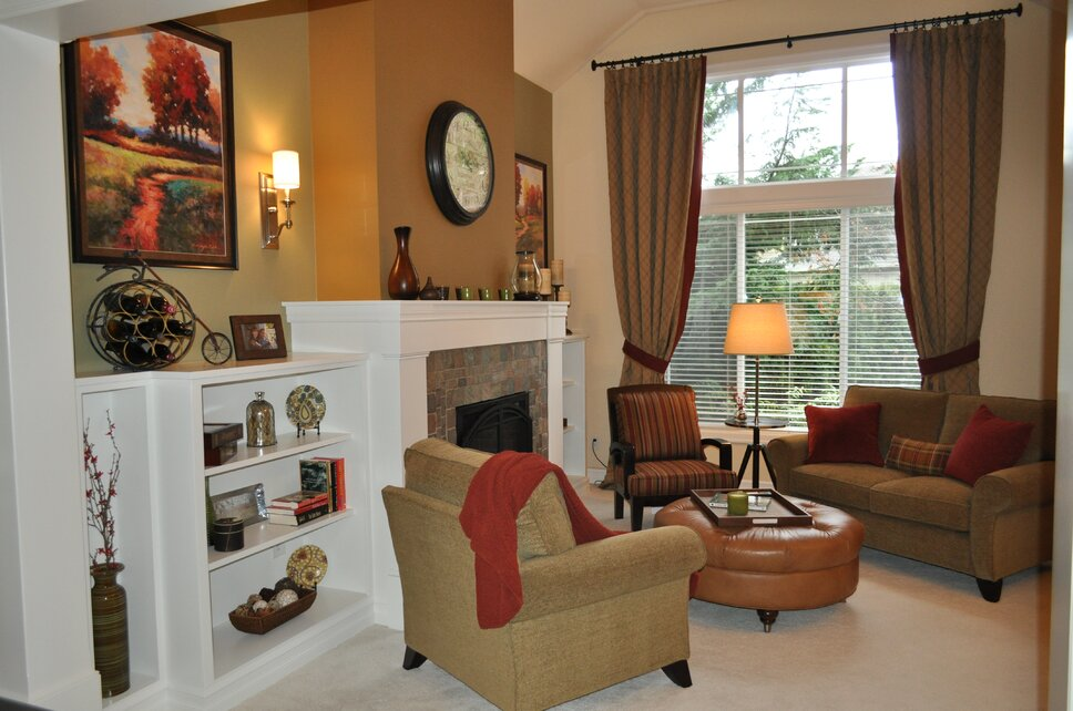 Custom 2 story drapes make the room feel large but still allow for light to come in. Traditional Living Room design