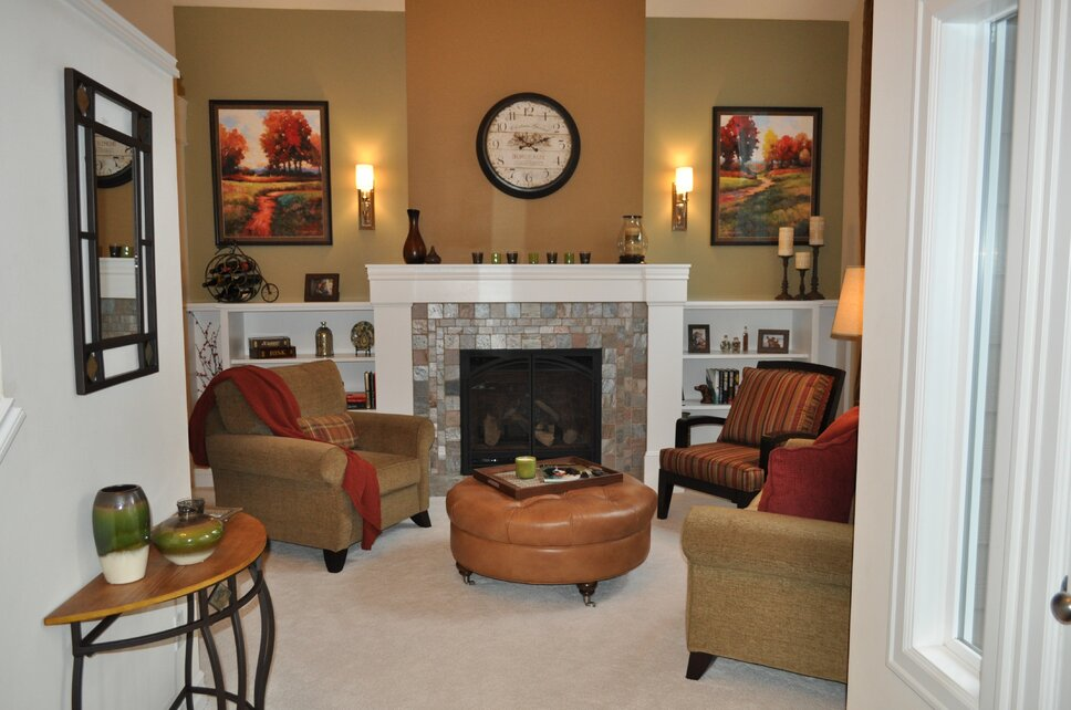 Fabulous color can make a room feel warm and inviting.  By adding the bookcases fun vases, books, and games can be stored in style. Traditional Living Room design