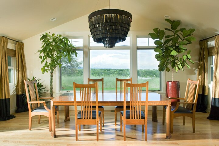 Mountain views from the dining room. I flanked the picture window with trees not window treatments as not to take away from the view. Ochre chandelier was a hard sell. They were only convinced after seeing them in Heathrow Airport. I knew I was right all along! Eclectic Dining Room design