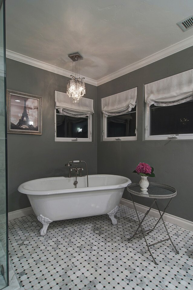 The vintage claw foot tub creates an appropriate juxtaposition to the modern, masculine custom shower.  LONDON JEWELL INTERIOR DESIGN Contemporary Bathroom design
