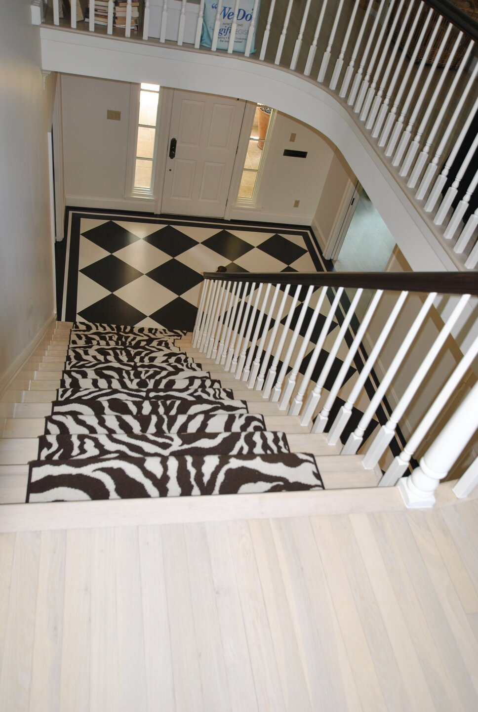 Zebra carpet from Creative Flooring. Custom bleached floors by Schenck  Co. Faux painted first floor by Decorative Arts. Traditional Entryway & Hallway design