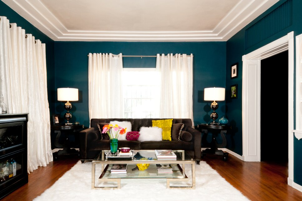 Colorful teal living room in residential apartment Glam Living Room design