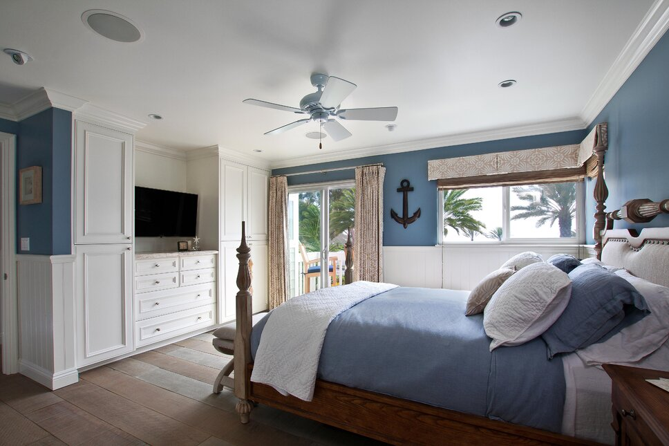 Photography by Ken Henry Coastal Bedroom design