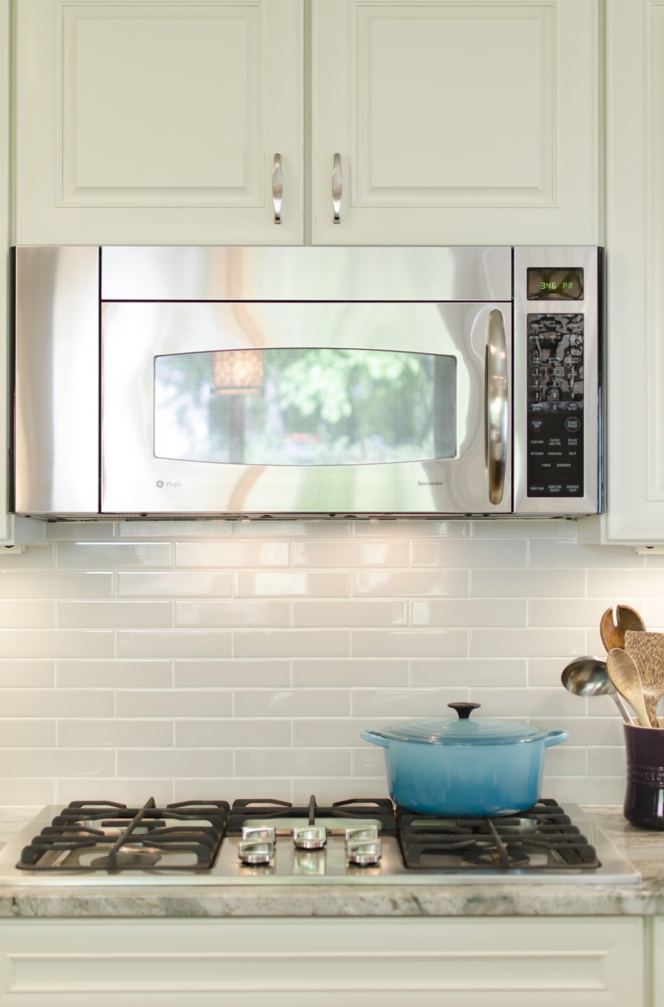 Because the granite was so active and interesting, we chose a simple dove gray subway tile, but in a 2x8 size to add extra visual interest. Contemporary Kitchen design