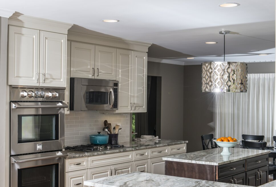 The light fixture over the island creates a warm glow and an interesting pattern on the walls and ceiling in the space. Contemporary Kitchen design