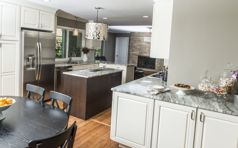 We wrapped the cabinets around the wall into the eat-in side of the kitchen for extra storage.  We intentionally chose to not do upper cabinets, as this allowed for a serving area for the homeowner to set out food for meals- whether for a party or just family dinner. Contemporary Kitchen design