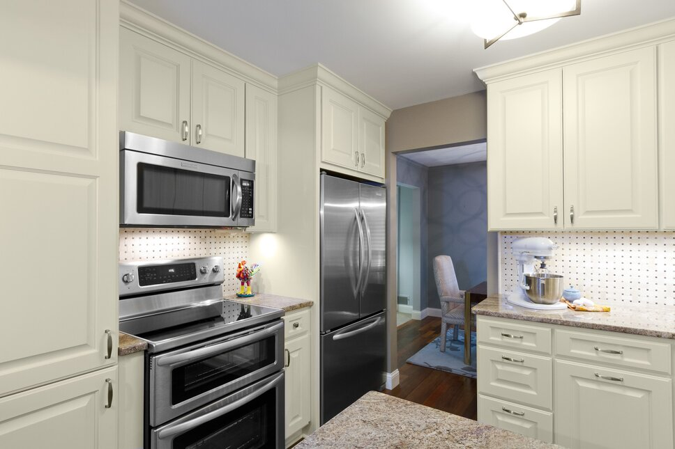 In order to maximize the function of this kitchen, we selected an oven range that had two ovens built in so they have the functionality of double ovens in the space of a single oven.  By using the microhood instead of a built in or counter microwave, we again gain counterspace and make this small kitchen extra functional. Traditional Kitchen design