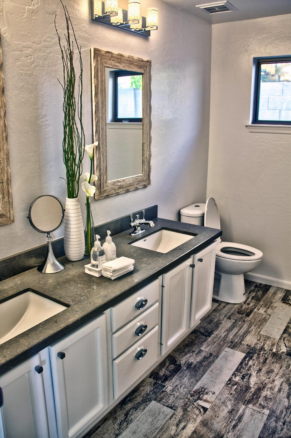 Refreshing makeover for guest bathroom. Porcelain wood flooring, Brushed Nickel Fixtures, Coordinating Light Fixtures, Limestone Countertop. Contemporary Bathroom design