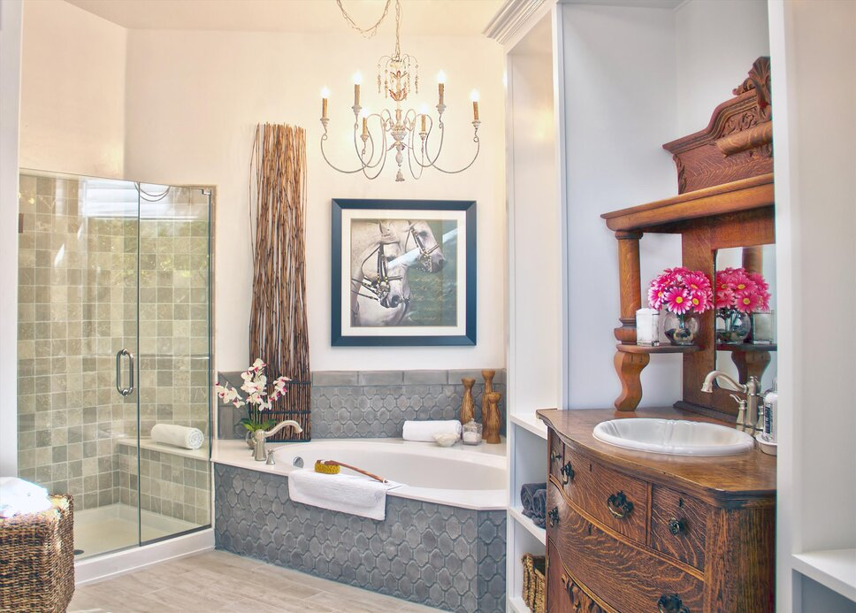 Travertine, Porcelain, Custom Brick Hard Surfaces. Antique Hutch converted vanity.  Brushed Nickel Finishes. Custom Built-in. Traditional Bathroom design