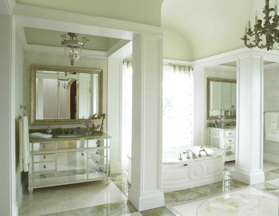 The area was created around the flooring, which featured cut onyx inlaid in a circular design. The layout prompted his-and-her vanity area. Traditional Bathroom design