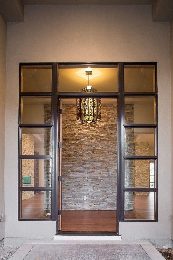 the shoji style light makes a welcoming statement with the stone in the background Contemporary Entryway & Hallway design