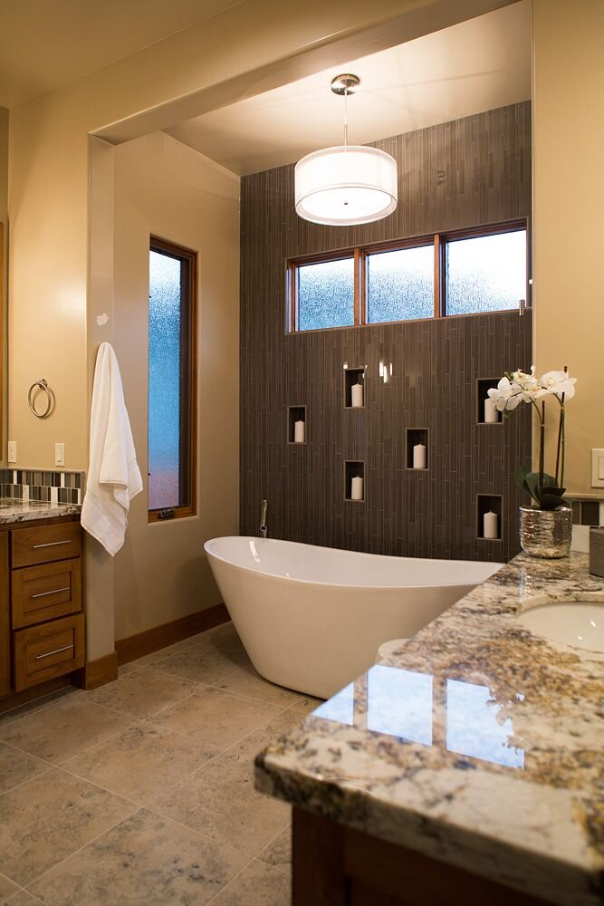 The tile wall with the candle niches sets the tone for a relaxing bath Contemporary Bathroom design