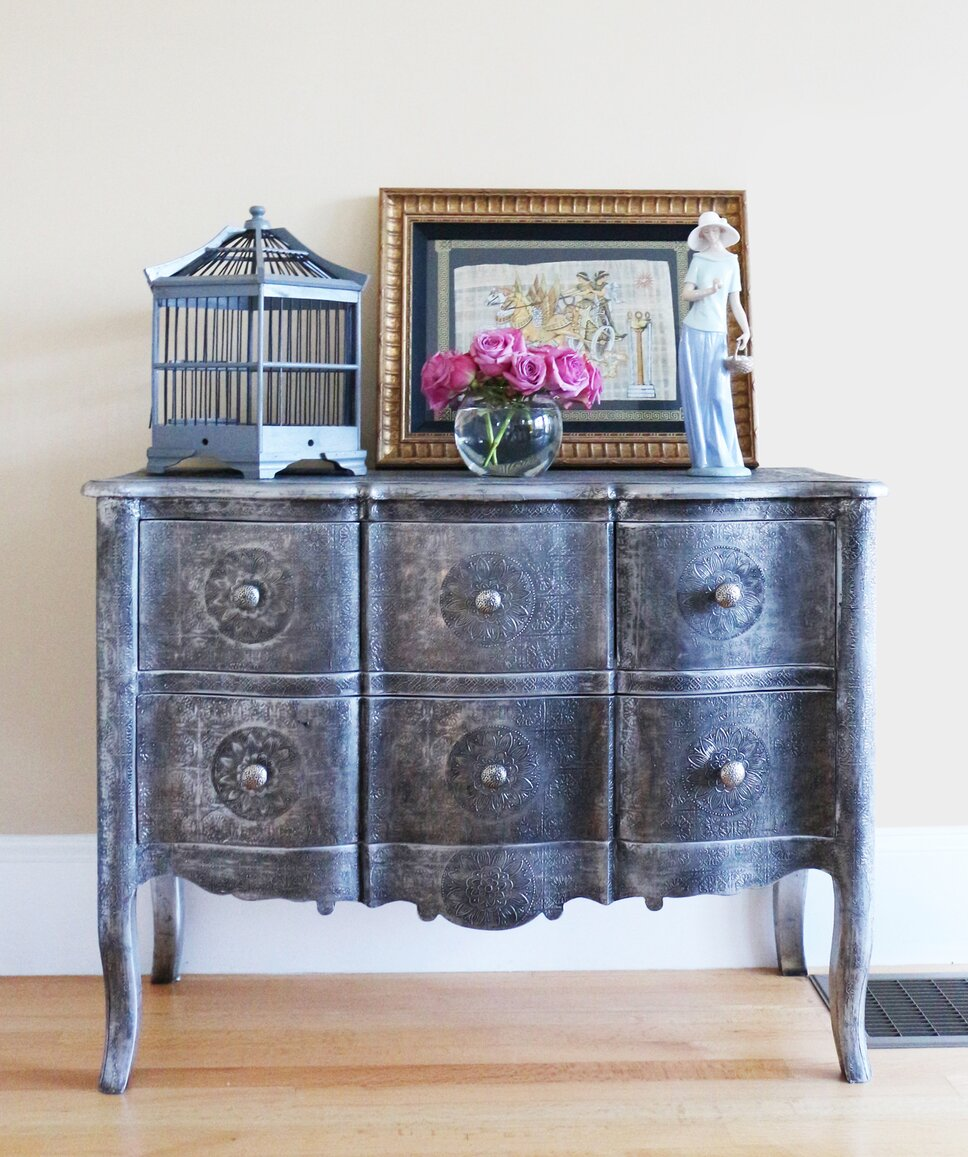 A whimsical and graceful chest in an elegant parlor. Traditional Living Room design