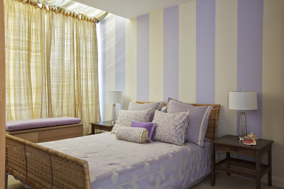 This teenager's bedroom presents a warm and whimsical theme with its lavender and cream stripe wall matching the bedding ensemble. Photographer Scott Morris Contemporary Bedroom design