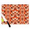 KESS InHouse Orange Swirl Kiss Cutting Board