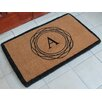 A1 Home Collections LLC First Impression Kepano Abstract Circle Monogrammed Doormat