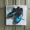 Amoloulou Football Boots by Amoloulou Original Graphic Art Wrapped on Canvas