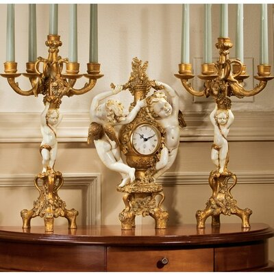 Design Toscano The Cherub's 3-Piece Harvest Clock and Candelabra Set in Ivory and Antiqued Faux Gold