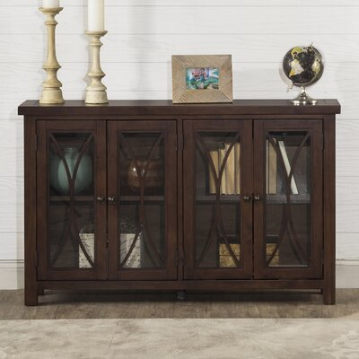 Sierra Madre 4 Door Accent Cabinet Color: Mahogany