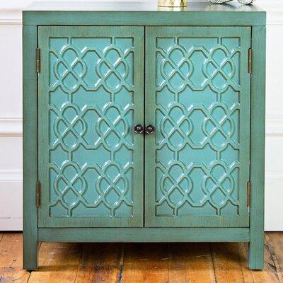 Ellzey Antiqued Quatrefoil 2 Door Accent Cabinet