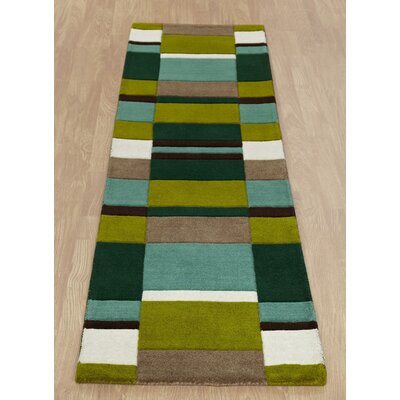 Caracella Handgearbeiteter Teppich Jazz in Grün