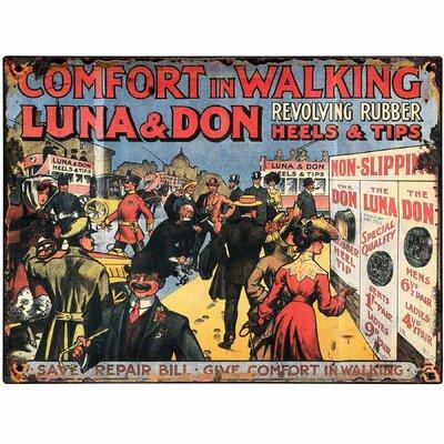 Hill Interiors Luna and Don Revolving Rubber Heels Vintage Advertisement Plaque