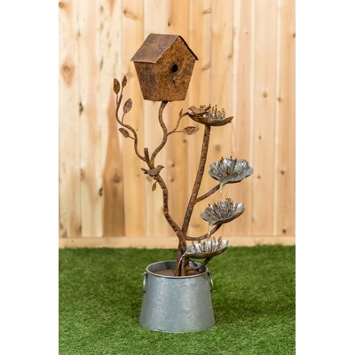 Metal Birdhouse with a Bird and leaves in a Pail Fountain