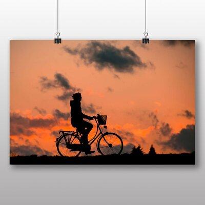 Big Box Art Riding a Bike Sunset Photographic Print