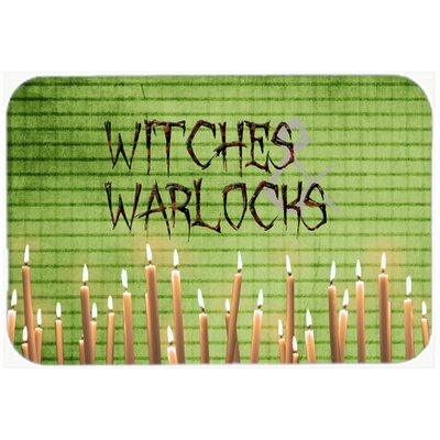 "Witches and Warlocks Halloween Kitchen/Bath Mat Size: 24"" H x 36"" W x 0.25"" D"