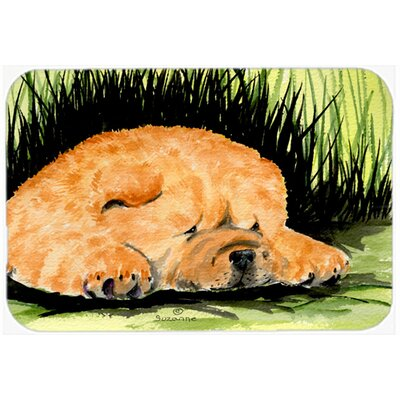 Brown Chow Chow and Green Glass Cutting Board