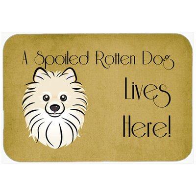 "Pomeranian Spoiled Dog Lives Here Kitchen/Bath Mat Size: 24"" W x 36"" L"