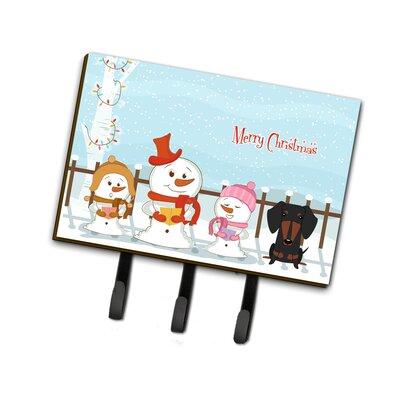 Merry Christmas Carolers Dachshund Leash or Key Holder Finish: Black