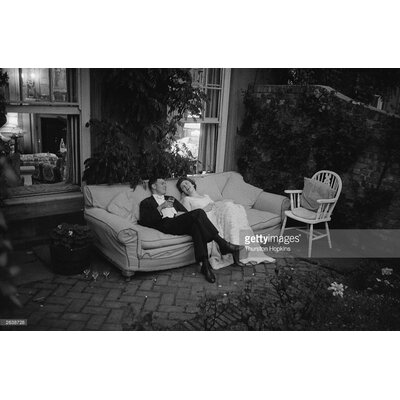 GettyImagesGallery Couple At Party byThurston Hopkins Photographic Print