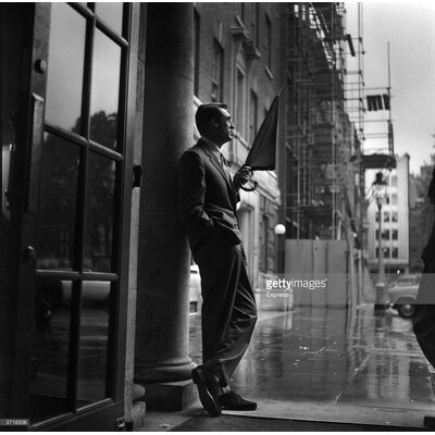 GettyImagesGallery Cary in the Rain by Express Photographic Print