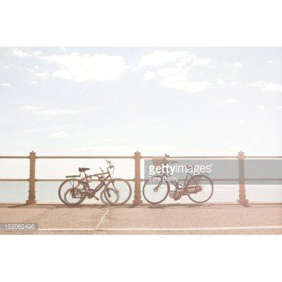 GettyImagesGallery Bikes Against Beach Railings by Ezra Bailey Photographic Print
