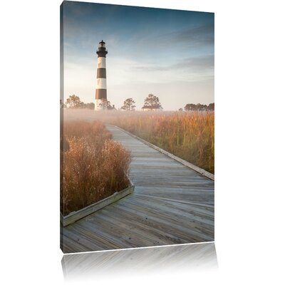 Pixxprint Foggy Beach with Lighthouse Photographic Print on Canvas