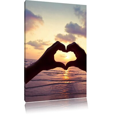 Pixxprint Heart Formed by Hands at the Ocean Photographic Print on Canvas