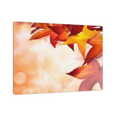 Klebefieber Herbstblätter im Lichtschein Cutting Board