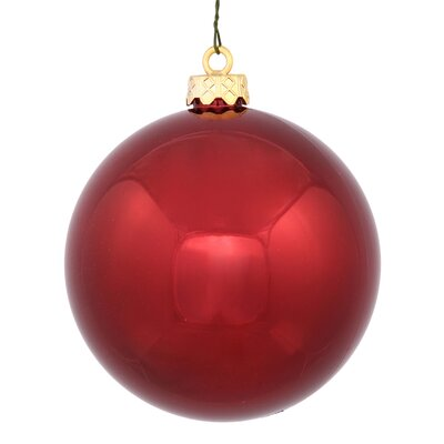 "UV Drilled Shiny Ball Ornament Size: 4.75"", Color: Burgundy"