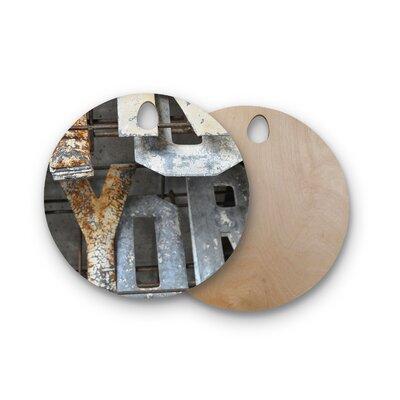 Jennifer Rizzo Birchwood Patina Letters Cutting Board Shape: Round