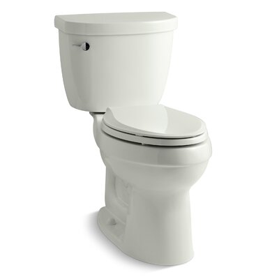 Cimarron Comfort Height Two-Piece Elongated 1.28 GPF Toilet with Aquapiston Flush Technology and Left-Hand Trip Lever Finish: Dune