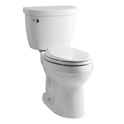 Cimarron Comfort Height Two-Piece Elongated 1.28 GPF Toilet with Aquapiston Flush Technology and Left-Hand Trip Lever Finish: White
